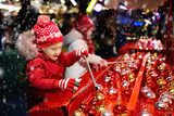 Kids at Christmas fair. Children shopping xmas gifts. - 181659443