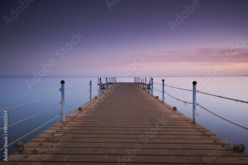 Aluminium Pier Wooden pier or jetty on sea sunset and sky reflection water. Long exposure, Dahab, Egypt