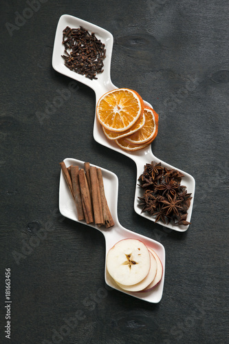 Sticker Ingredients for Hot mulled wine with apple, orange, anise and cinnamon with fresh fruits on wooden table. Winter and fall. Christmas and holidays food.