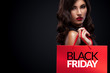 Shopping woman holding red bag in black friday holiday