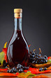 Black chokeberry and bottle with juice .