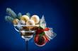 Christmas balls in wineglass .