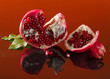 Pomegranate with leaves .