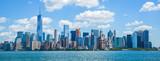 Lower Manhattan cityscape from Ellis Island dock. - 181675844