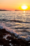 Water splash in the sea at sunset - 181678873