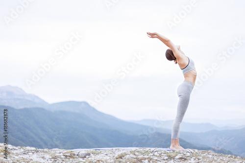 Naklejka Fit girl practicing morning yoga and sun salutation