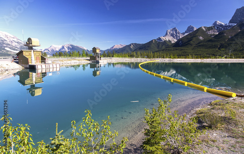 Foto op Canvas Canada Rundle Forebay Water Reservoir Landscape above City of Canmore with Distant Three Sisters Mountain and Alberta Foothills east of Banff National Park in Canadian Rockies