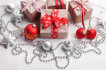 Christmas handmade  presents with red ribbon on white  wooden background