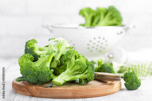 Poster Fresh broccoli on white background closeup