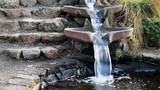 Water Flow Form Spilling Into Pond With Stone Steps - 181686002
