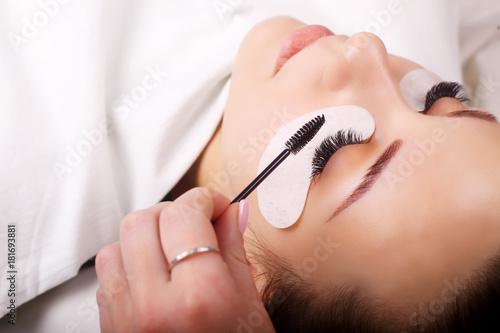 Fotobehang Spa Eyelash Extension Procedure. Woman Eye with Long Eyelashes. Lashes, close up, macro, selective focus.
