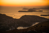 Sunset on the Adriatic sea with layers mountains on the horizon. Beautiful panoramic view of Dubrovnik, Croatia. - 181694202