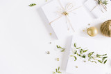 Christmas gift boxes decorated with green branches and Christmas balls. New Year's composition.