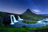 Starry sky on Kirkjufellsfoss waterfall.