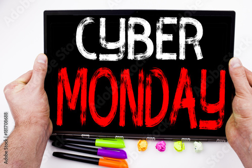 Cyber Monday text written on tablet, computer in the office with marker, pen, stationery. Business concept for Retail Shop Discount white background with copy space