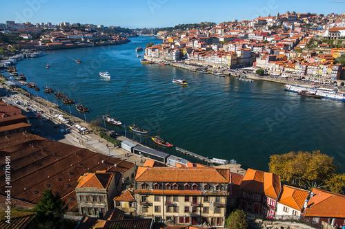 View of the old downtown of Porto and Douro river from Vila Nova de Gaia, Portugal.