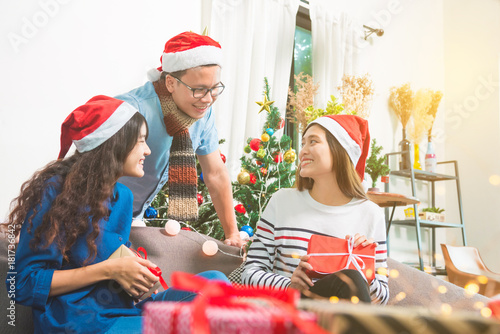 Young adult asian people talking with smiles in christmas party Poster