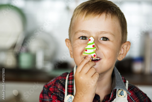 Sticker Cute boy with a ginger bread Christmas tree
