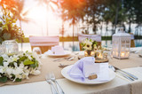 Romantic dinner setting at pool with sunset on the beach - 181741038