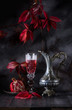 Still life a vintage jug of wine, a glass goblet and a pomegranate