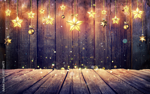 Glowing Christmas Stars Hanging At Rustic Wooden Background