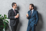 businessmen with coffee to go - 181759061
