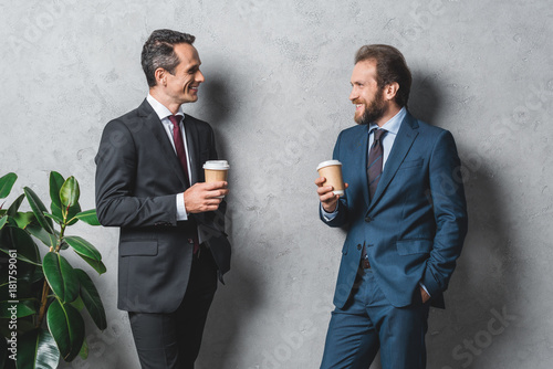 Fridge magnet businessmen with coffee to go