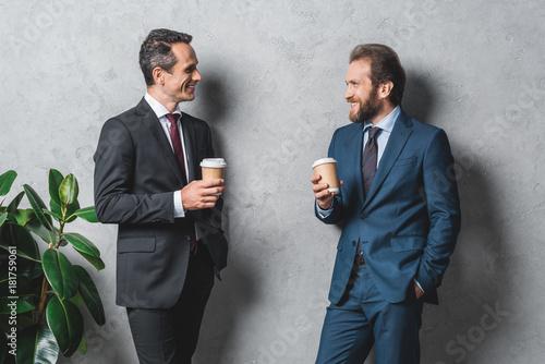 Fototapeta businessmen with coffee to go