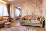 Living room with soft sofa, wallpaper with grapes and purple carpet - 181759441