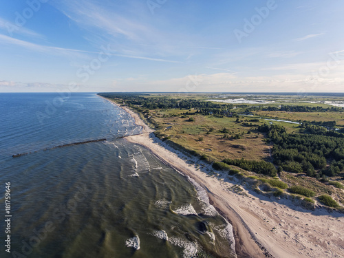 Tuinposter Blauwe hemel Aerial view over a Baltic Sea shore line in Pape, Latvia. During summer season.