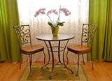 Two shod chairs and little table about a window of a modern classical drawing room - 181766472