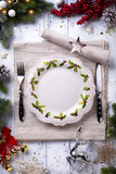 Christmas holiday dinner background; empty dish, cutlery and Christmas tree decoration - 181770809