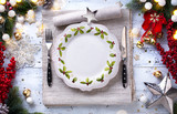 Christmas holiday dinner background; empty dish, cutlery and Christmas tree decoration - 181771892