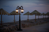 Empty embankment with straw umbrellas and streetlights in Dahab at night - 181779041