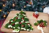 Christmas tree of broccoli green with tomatoes