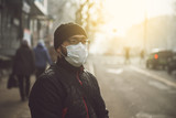 A man wearing a mask on the street. Protection against virus and grip - 181800096