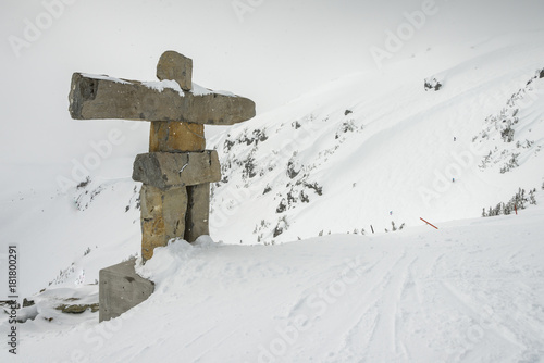 Poster Canada Inukshuk made of stones on snow covered mountain, Whistler, British Columbia, Canada