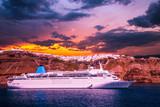 Santorini, Cyclades Islands, Greece. Luxury cruise ship in the bay of Santorini at sunset - 181809430
