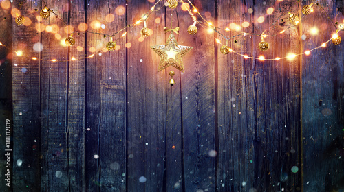 Foto op Aluminium Hoogte schaal String Light Hanging At Vintage Wooden Background