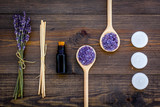 Skin care and relax. Cosmetics and aromatherapy concept. Lavender spa salt and oil on dark wooden background top view - 181819004