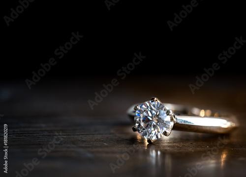 Diamond ring on the wood - 181820219