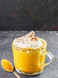 golden turmeric latte and ingredients, copy space - 181827866
