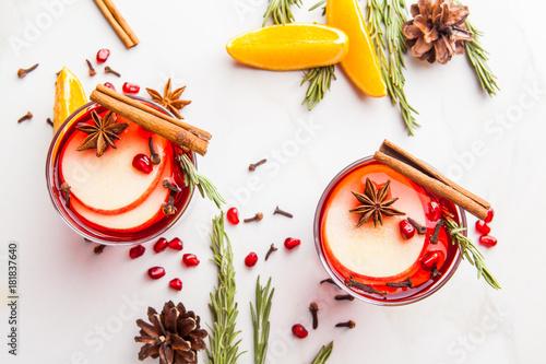 Fototapeta Christmas. Winter cocktail grog, hot sangria, mulled wine. On white marble table.