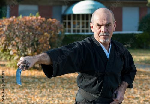 Iaido instructor draws his sword katana Poster