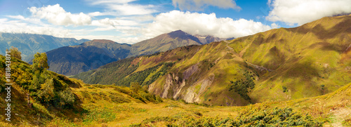 Poster Honing Amazing panoramic view to Caucasus Mountains. Densely coniferous forests and high mountain peaks. Sunny day with blue mountains. Svaneti, Geogria.