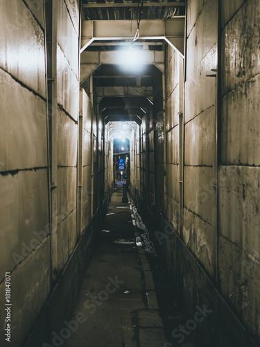 Plexiglas Smalle straatjes scary tunnel going alone dark lights