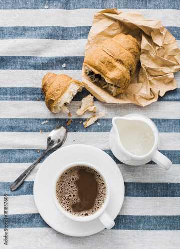 Poster Koffiebonen Cappuccino on a striped tablecloth. Morning coffee.