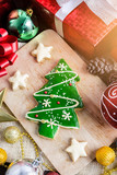 Christmas Cookie and New Year in the shape of Christmas tree on table - 181867639