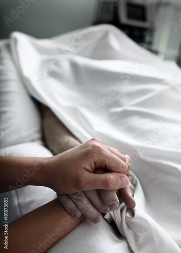 Parting with dead patient covered with bed sheet in the hospital