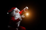 Santa Claus with a lantern isolated on white background. - 181874653
